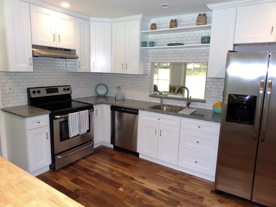 ready for dinner? new appliances, granite counter tops and fresh flooring. upgrades and a new fresh country kitchen.
